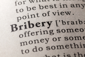 Today, society gains knowledge about corruption and manipulation cases more and more frequently. Scientists will discuss bribery, fraud, and cheating in Hanover, Germany. (Photo: Feng Yu - Fotolia.com)